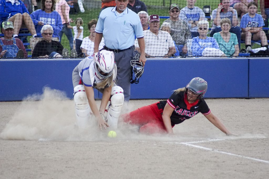 CLOSE PLAYS THE RULE IN HIGH SCORING CONTEST-Knox County senior Taylor Walker slides in with a Lady Eagle run at Scotland County. Lady Tiger catcher Brenna Phillips makes a play on the throw. Scotland County took a 19-11 win. Photo by David Sharp.