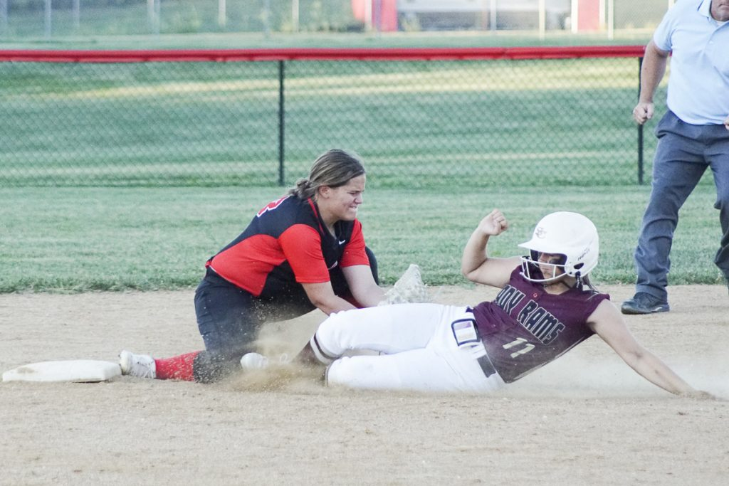 LADY EAGLES CATCH WOULD BE BASE THIEF-Knox County second baseman Baila Miller (shown on the left) took a throw from catcher Taylor Walker then tagged Schuyler County runner Tinley Roberts for the second out of the seventh inning at Knox County. The Lady Rams got a four hit, three home run performance from pitcher Kait Hatfield for a 7-0 conference win. Photo by David Sharp.